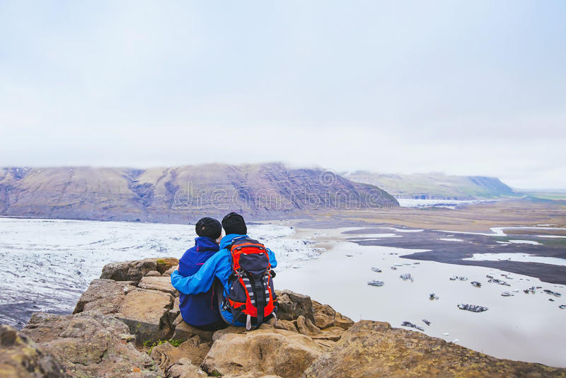 Couple of hikers travel in Iceland royalty free stock photography