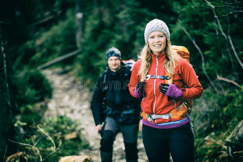 Couple hikers walking hiking stock images