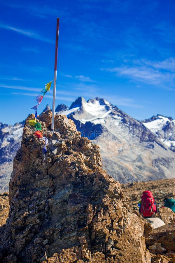 A couple hiking and conquering a peak in Cerro Castillo, Patagonia, Austral Road, Chile royalty free stock images
