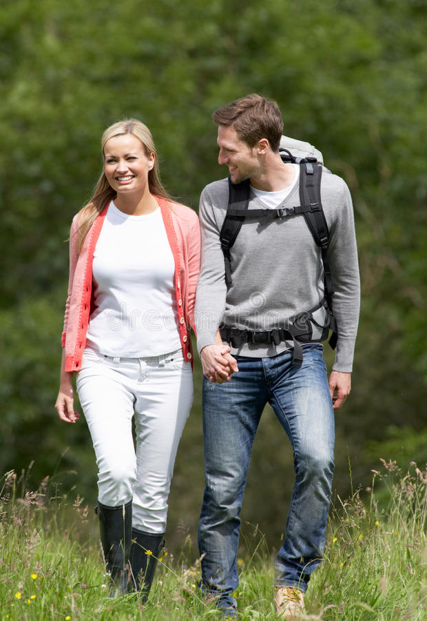 Couple Hiking In Countryside stock image
