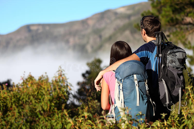 Couple hiking looking at view stock photos