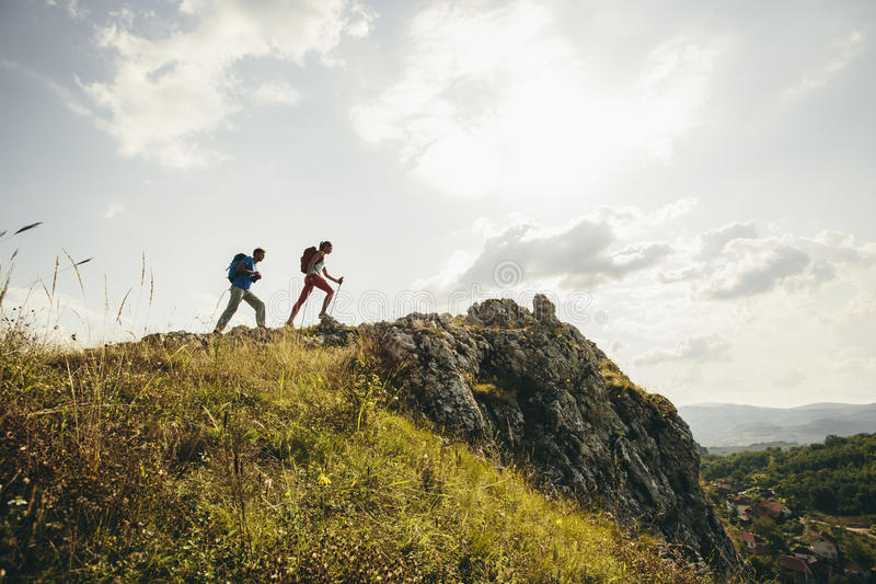 Couple hiking in the mountains royalty free stock images