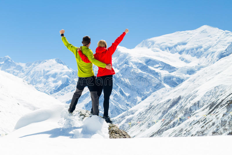 Couple hiking success winter mountains stock image