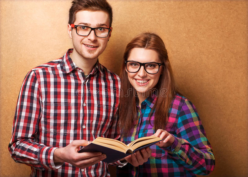 Couple hipsters in studio royalty free stock images