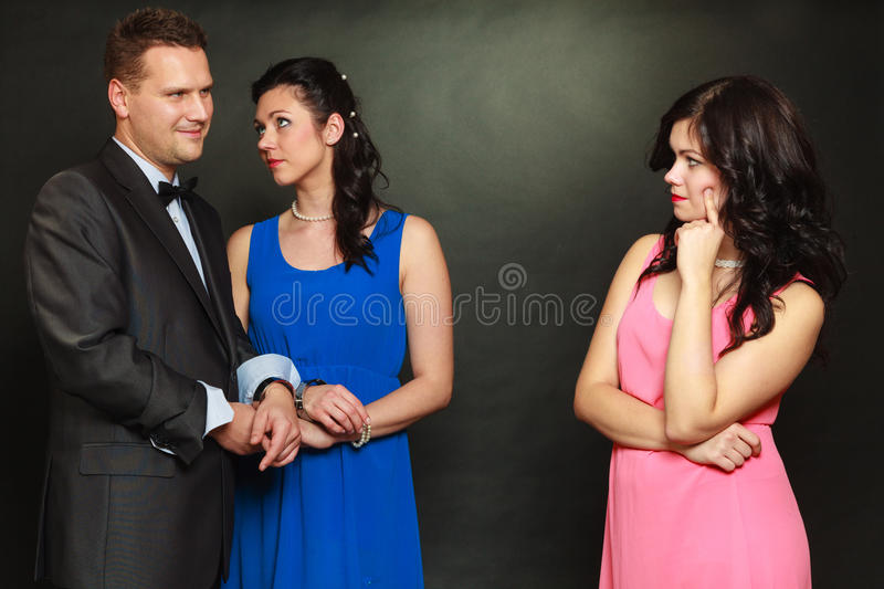 Couple and his jealous woman lover stock image