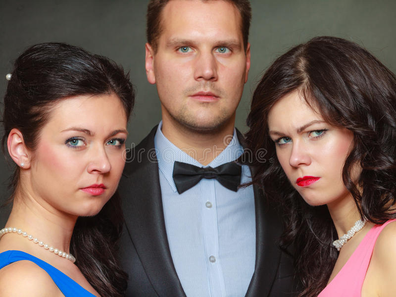 Couple and his jealous woman lover royalty free stock photos