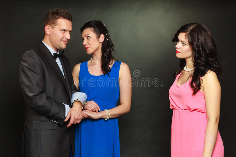 Couple and his jealous woman lover stock photos