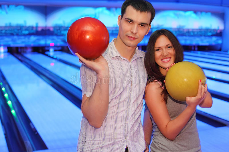 Download Couple Hold Balls In Bowling Club Stock Photo - Image: 25150360
