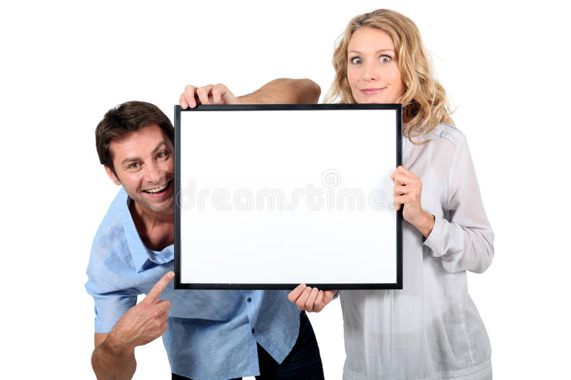 Download Couple Holding Blank Picture Frame Stock Photo - Image: 22726632