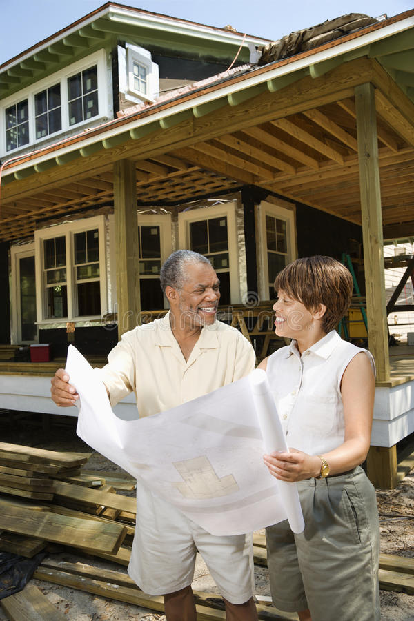 Couple Holding Building Plans Stock Photo
