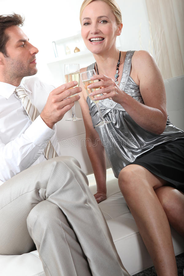Couple holding champagne glasses royalty free stock photo