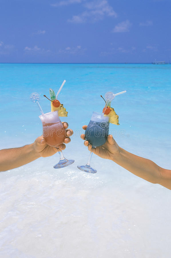 Couple Holding Cocktail In Tropical Beach Maldives Royalty Free Stock Photo