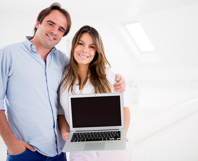 Download Couple holding a computer stock photo. Image of content - 26657228