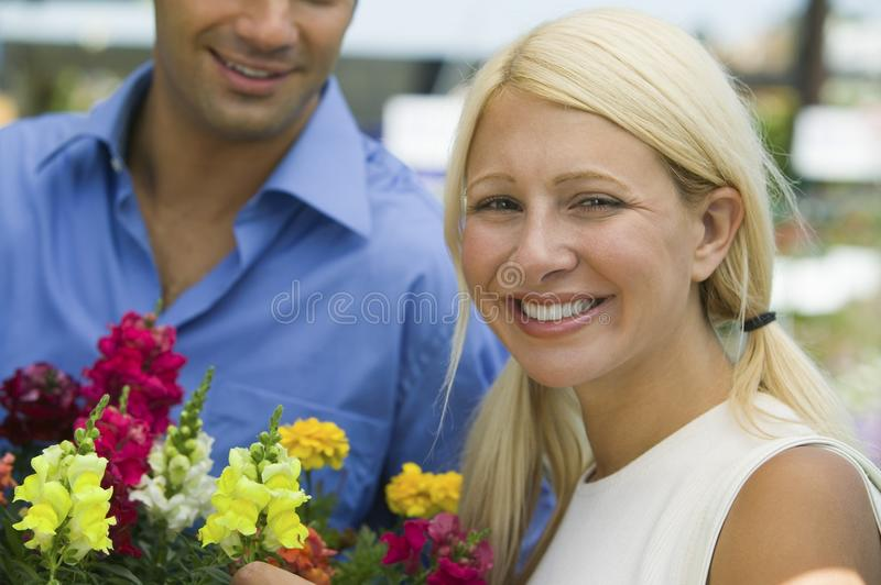 Couple Holding Flowers royalty free stock photo