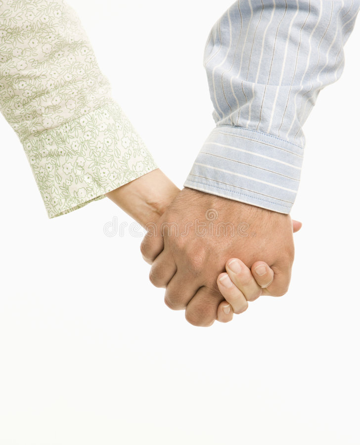 Couple holding hands. stock photos