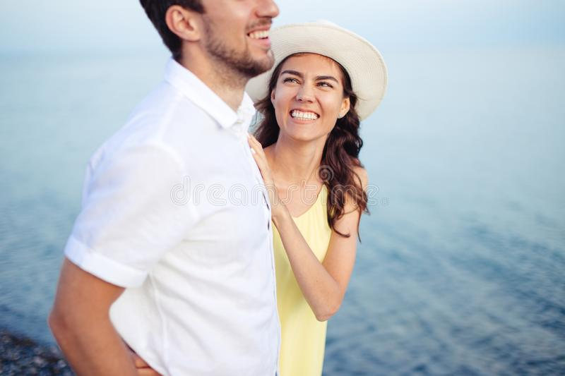 Couple holding hands on beach and walk and enjoy together stock image