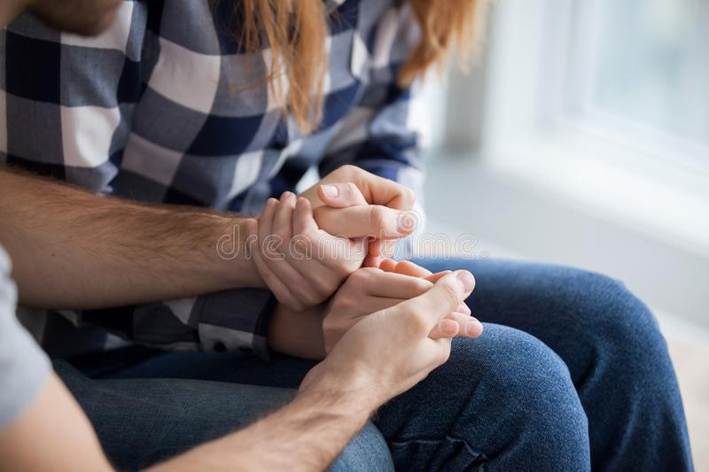 Couple holding hands, showing love and empathy close up stock photography