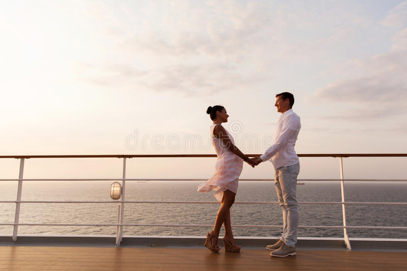 Couple holding hands cruise royalty free stock image