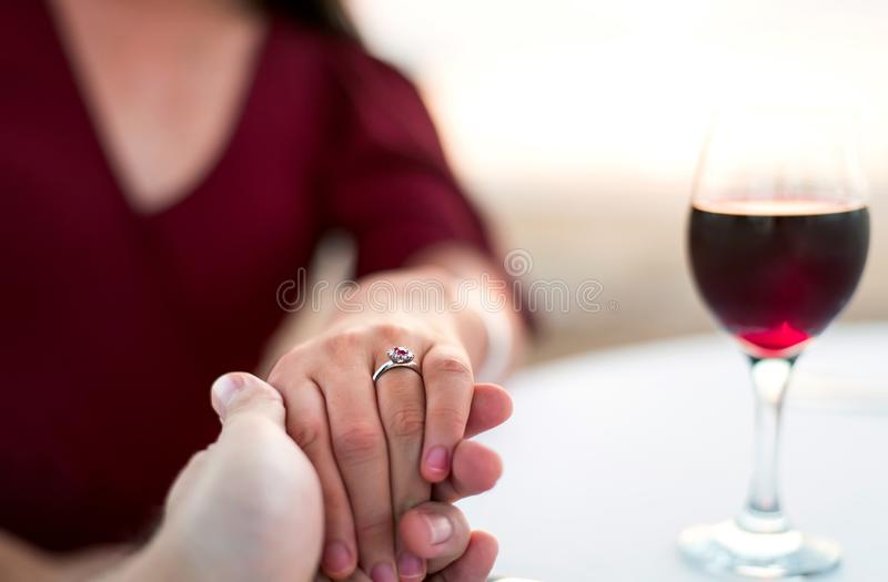 Couple holding hands on a date stock image