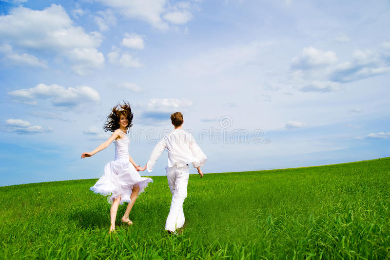 Couple Holding Hands In A Field Stock Images