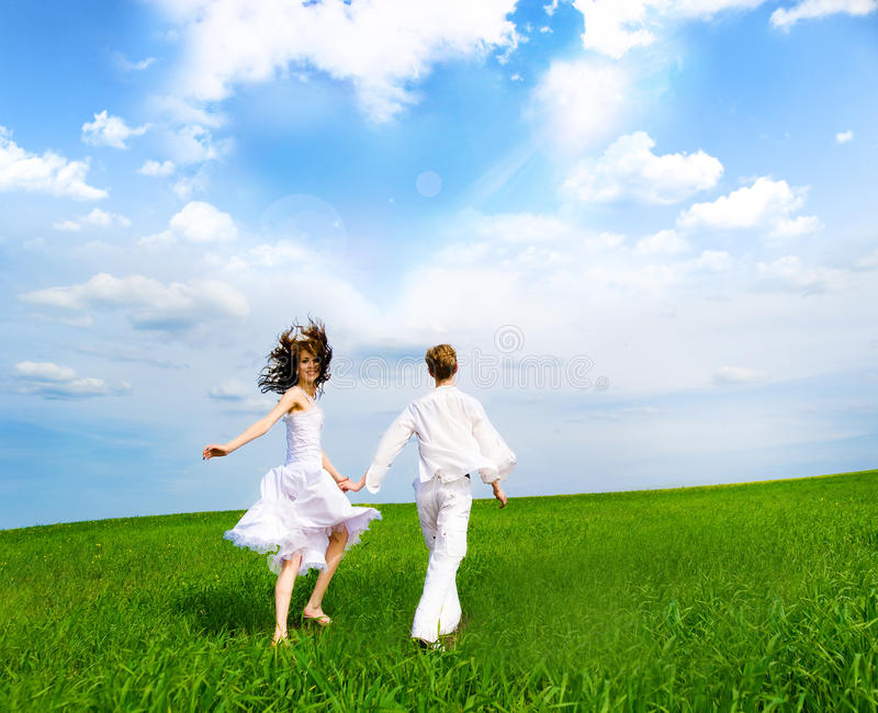 Download Couple Holding Hands In A Field Stock Photo - Image: 14972878