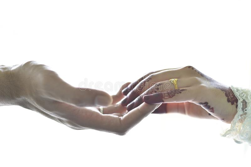 Couple holding hands high key photo. Wedding,marriage and love concept royalty free stock images