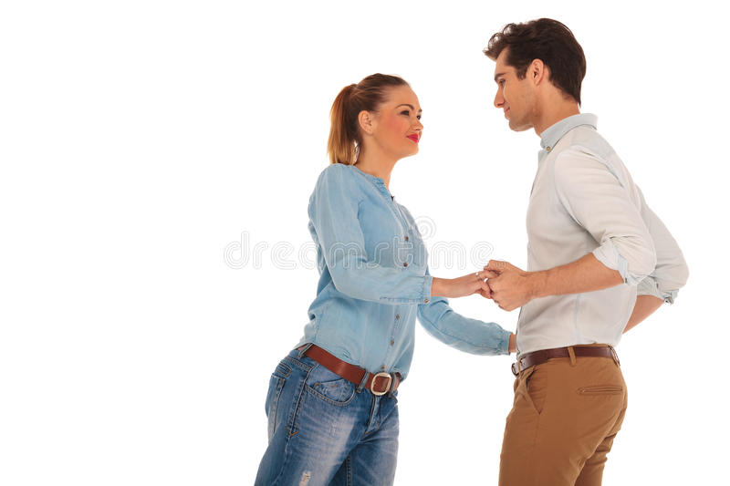 Couple holding hands and looking at each other royalty free stock image