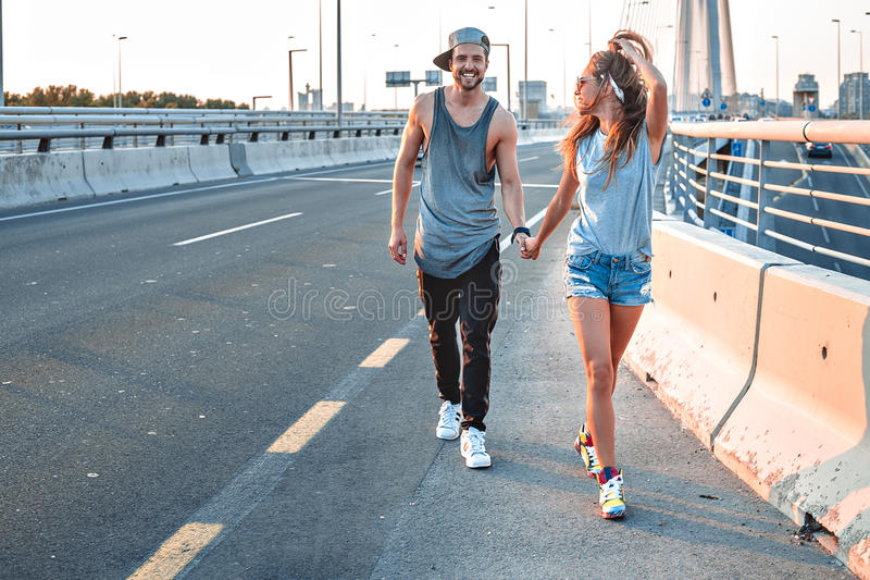 Couple holding hands on the street royalty free stock photos