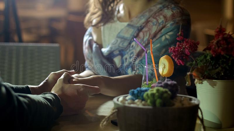 Couple holding hands tenderly, showing romantic feelings on date, love story. Stock footage royalty free stock photo