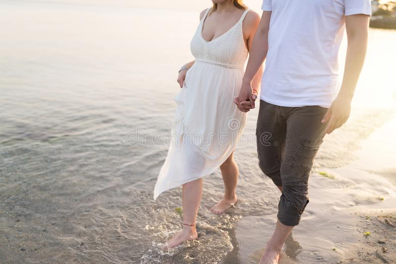 Couple holding hands walking romantic on beach on vacation travel holidays stock images