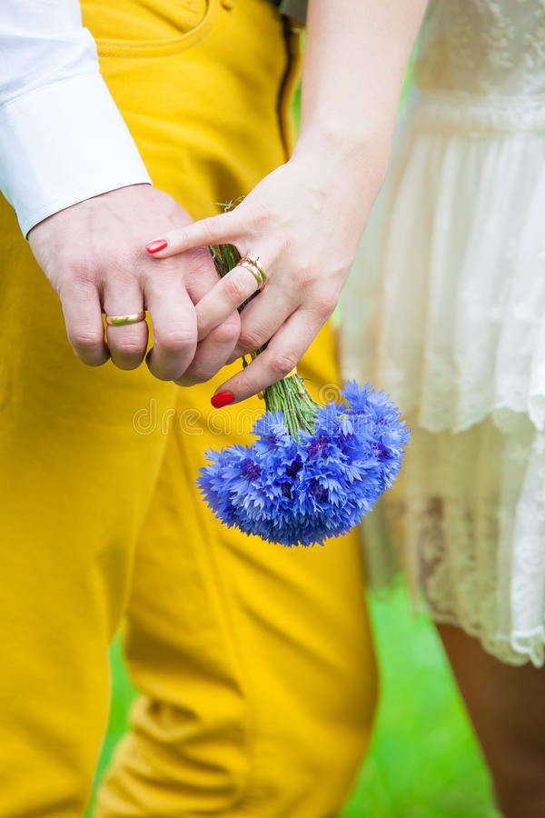 Couple holding hands. On weddings royalty free stock images