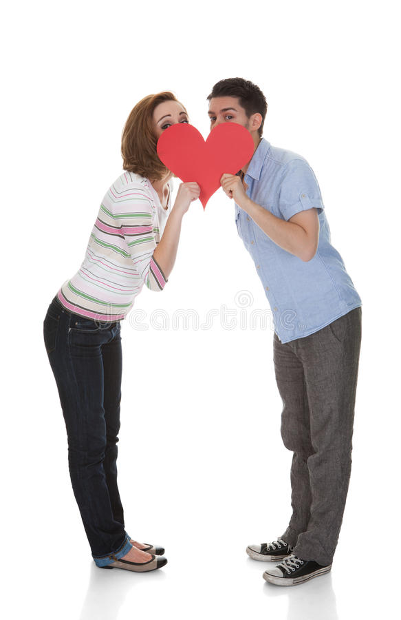 Couple Holding Paper Heart stock photography