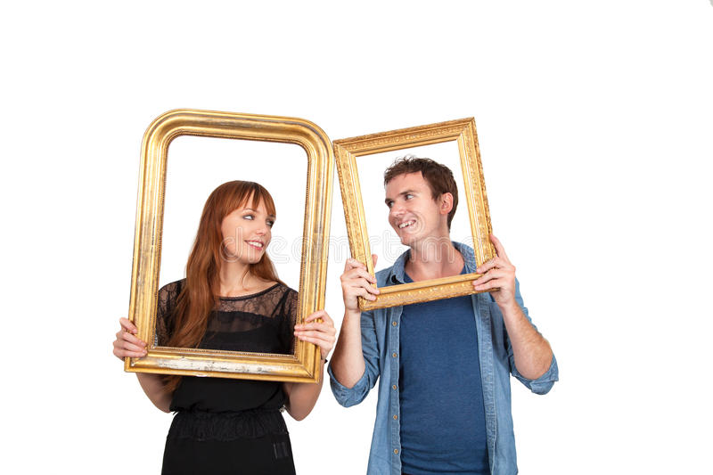 Couple holding picture frames stock images