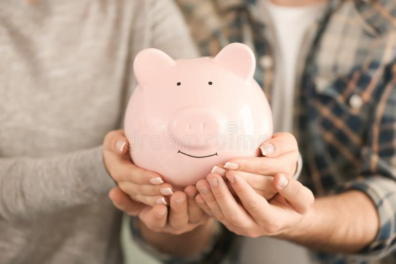 Couple holding piggy bank, closeup. Money savings concept stock photos