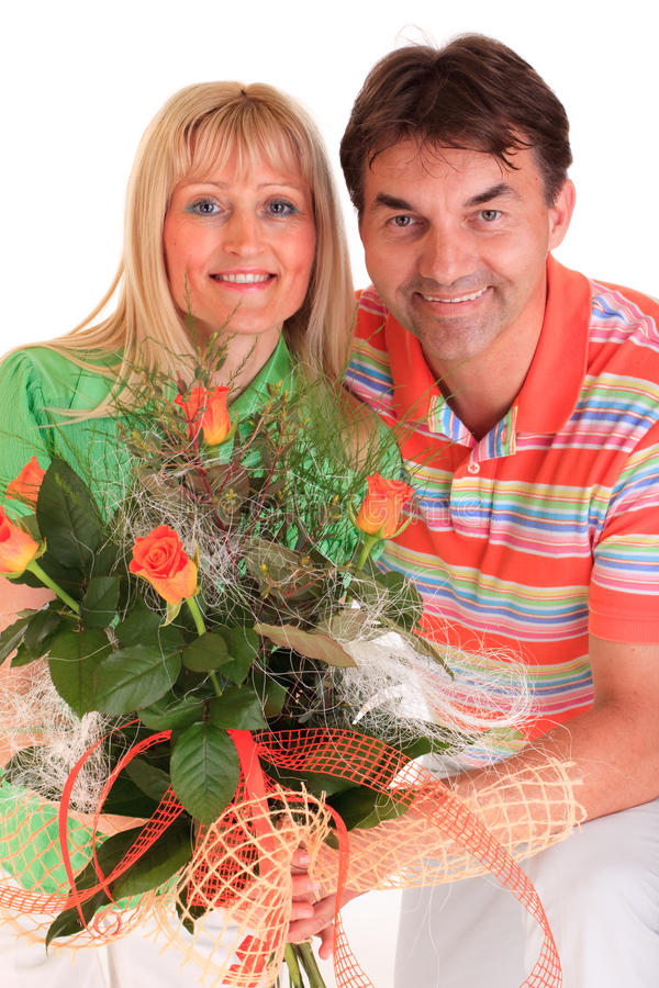 Couple holding roses stock photography
