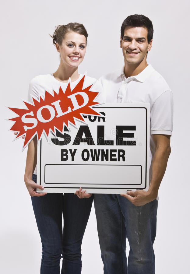 Download Couple Holding For Sale By Owners Sign Stock Photo - Image: 9913492