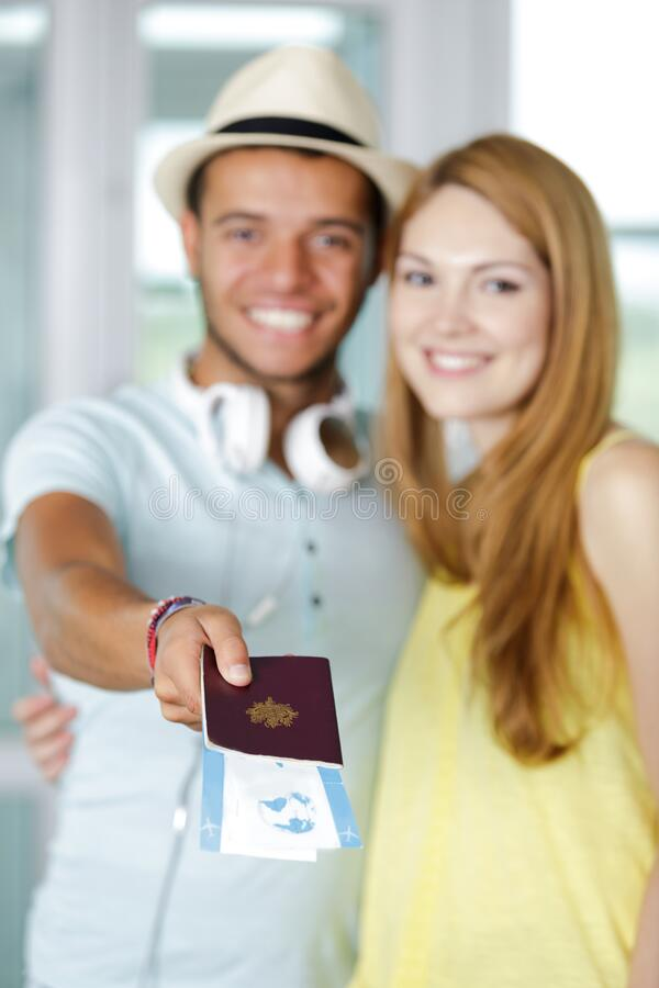 Couple holding travel tickets and passport royalty free stock photo