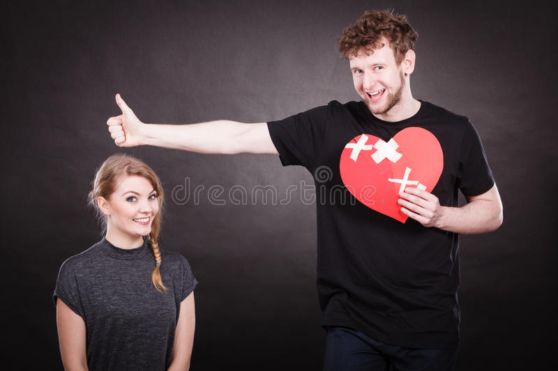 Download Couple Holds Broken Heart Joined In One Stock Photo - Image: 83709971
