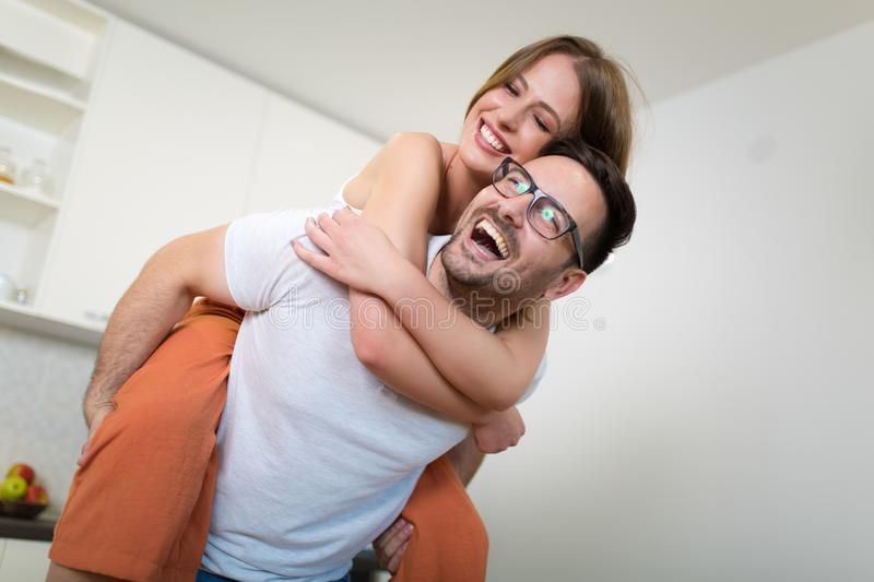 Couple at home. Attractive young woman and handsome man are enjoying spending time together stock photos