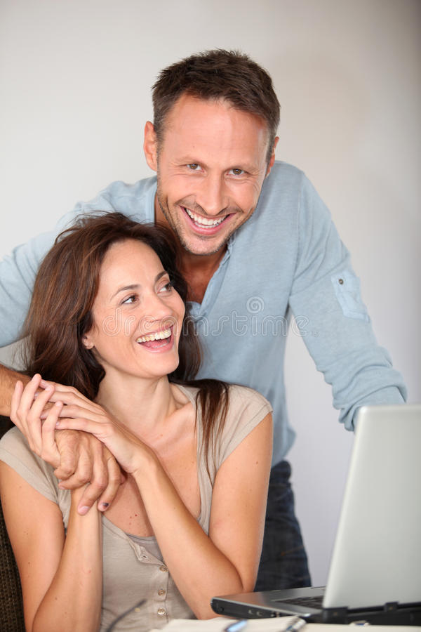 Couple at home with laptop computer royalty free stock images