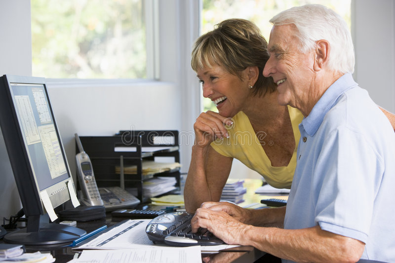 Couple in home office with computer stock photos