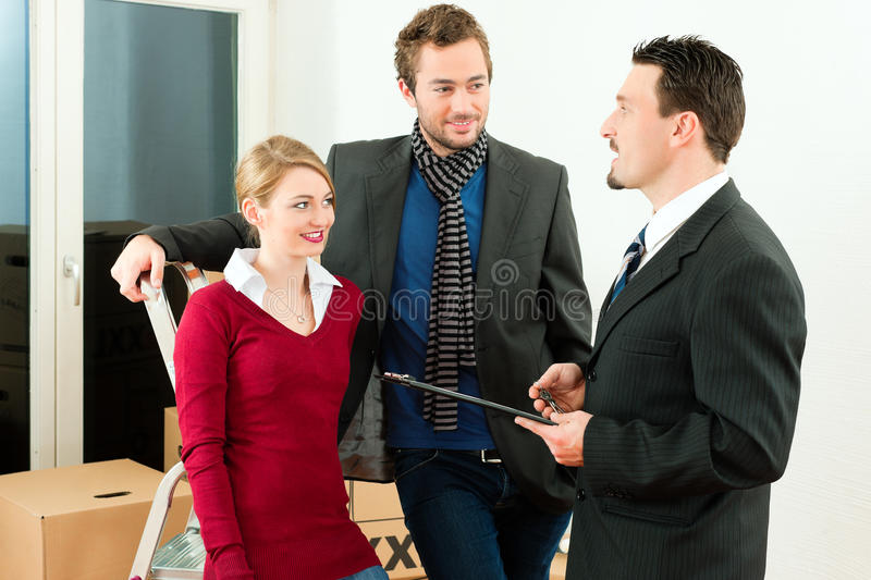 Couple in home with real estate broker stock photo