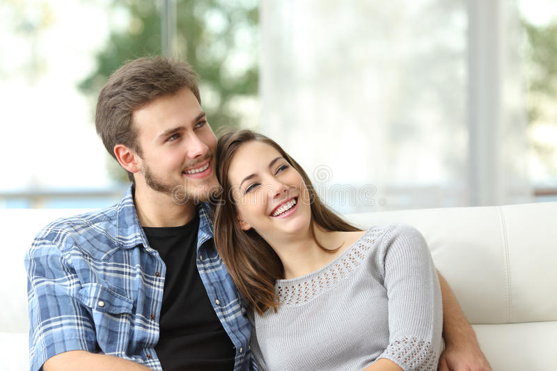Couple at home thinking and looking sideways royalty free stock photo