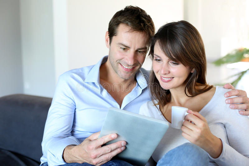 Couple at home using tablet royalty free stock photography