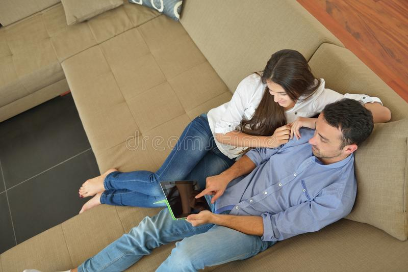 Couple at home using tablet computer royalty free stock photo