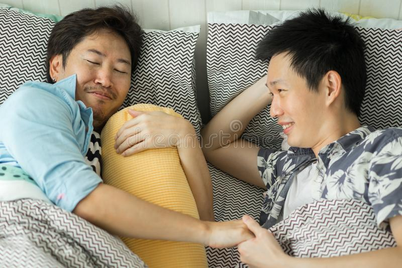 Couple Homosexuality relax on bed in bedroom. Love in boy concept royalty free stock photos