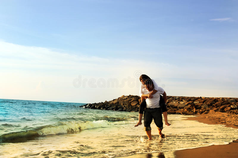 Couple Honeymoon At Beach Stock Photo