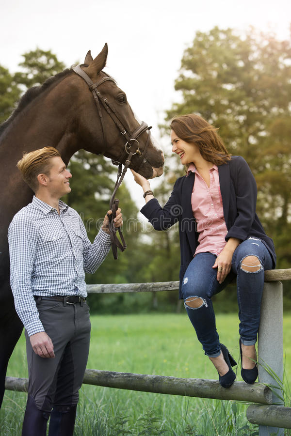 Couple with horse at a farm royalty free stock photos
