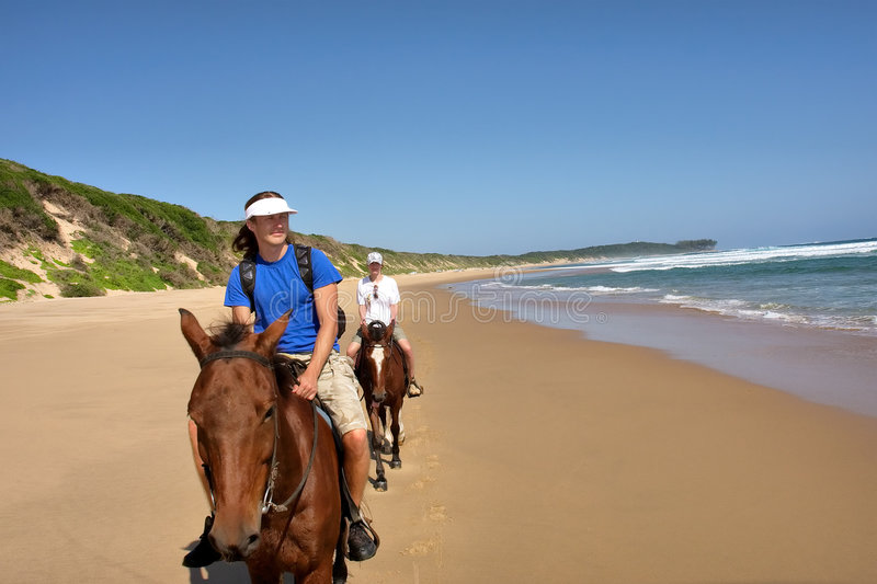 Couple Of Horse Riders On Beach Stock Images