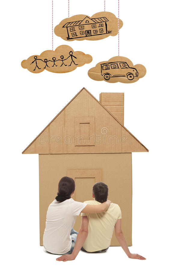 Couple with house of cardboard. Young couple with the house of cardboard. Photo and hand-drawing elements combined royalty free stock image
